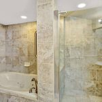 Bathroom with standing shower and separate tub